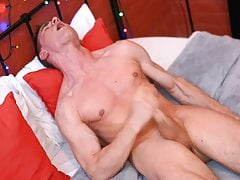 Marcus deep-throats the dildo while rubbing his bulge