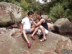 Twink sucks cock outdoors
