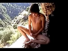 Jungle twink jerks and cums off a cliff -- HD videos at baresexyboys.com