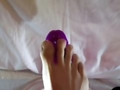 SUCKING FOOT JOB AND RIDING MY HUGE PURPLE DILDO
