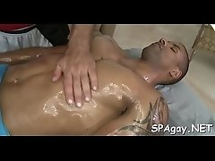 Cute twink gets a lusty massage from handsome gay stud
