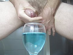 Ejaculating creamy cumshot into a cup of water #2