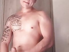 Muscular young man with big thick cock and cute cumshot