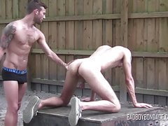 Blond thug teasing gay maledom during rough outdoor whipping