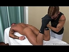 Inked hunk Michael Roman covers twinks tender feet with cum