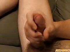 Tattooed twink relaxes by masturbating and cumming wildly