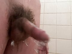 twink with a small hairy cock touches himself in the shower