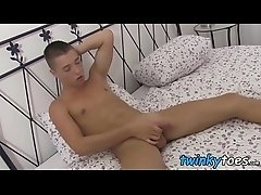 Foot loving twink strokes big shaved dick and teases solo