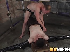 Sean enjoys restraining Aaron and and giving him a handjob
