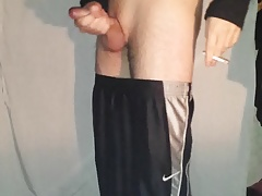 boy in sport shorts smoking and jerks ass play